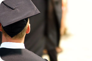 Image of student in graduate regalia.