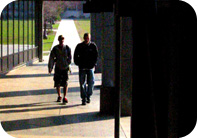 Image of two students walking.